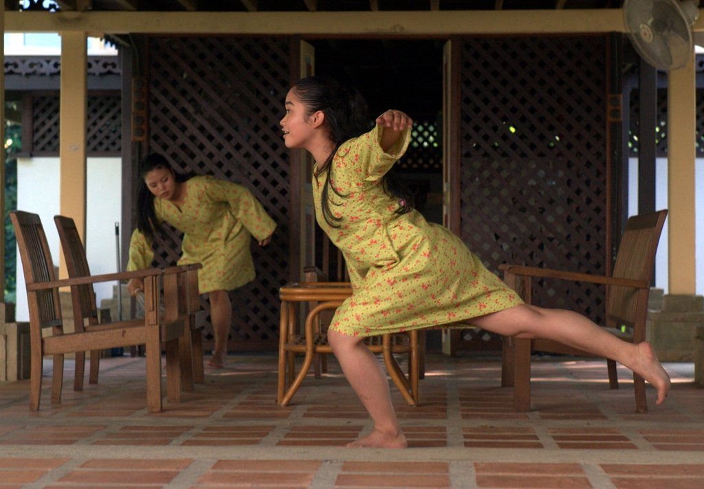 Nor Hidayah Binti Hayon (Yaya) in the foreground, in Nurulakmal Abdul Wahid's 'She Simply Disappears...' at Dancing in Place 2015, Rimbun Dahan. Photo: James Quah