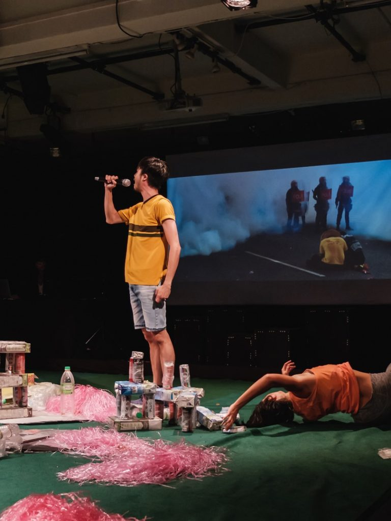 Roger Liew and Lee Ren Xin against a backdrop of Bersih protest images, Version 2020 (KL). Photo credit: Bryan Chang, courtesy of Five Arts Centre.